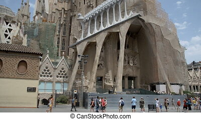 People looking up at Sagrada familia at Barcelona - Crowd of...
