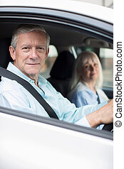 Portrait Of Smiling Mature Couple On Car Journey Together