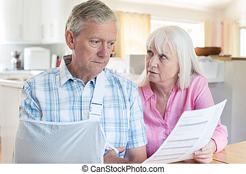 Couple Reading Letter About Husband's Injury