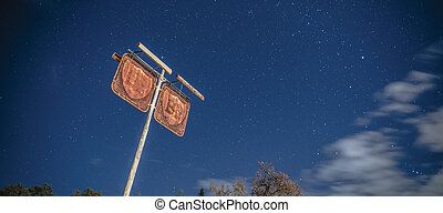 Old rustic fuel station sign in the countryside - Rusted...