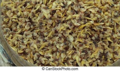 Dried salted fish snack to beer in supermarket stock footage...