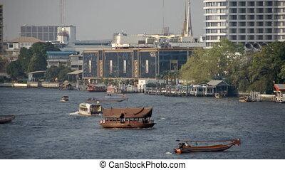 Several boats travelling in busy Bangkok river - Several...