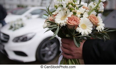 Wedding bouquet in front of luxury car, close up