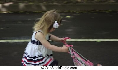 Mother and daughter wheeled strollers - Baby stroller rolls...
