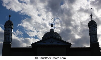 Mosque.3 - Time lapse clouds flowing past twin minaret...