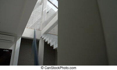 Interior of a modern art gallery - Panning shot showing the...