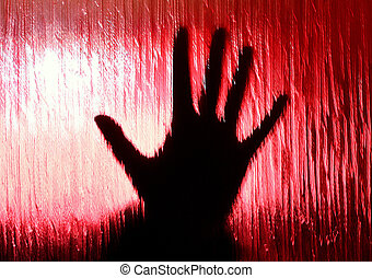 Spooky hand - Spooky looking hand behind a window