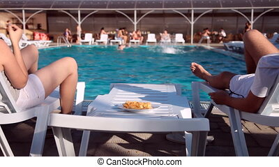 eating chips - adult couple enjoying relaxing vacation...
