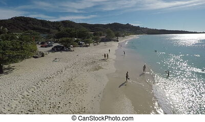Aerial drone of people walking on the beach - Aerial drone...
