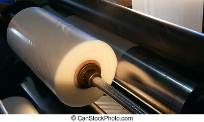 Move factory conveyer - Newspapers move along an overhead...