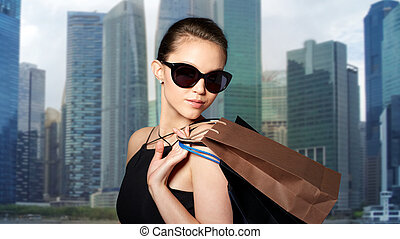 happy woman in black sunglasses with shopping bags - sale,...