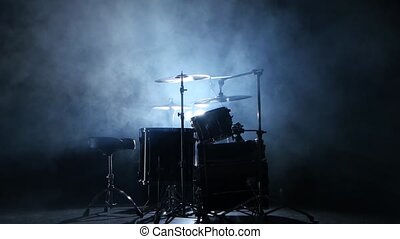 Drum kit for professional use. Black smoky background. Back...