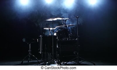 Professional drum set with chair. Black smoky background....