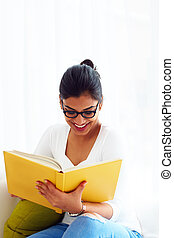 beautiful young indian girl, student with book, studying