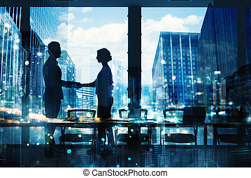 Handshake of two businessperson in office concept of...