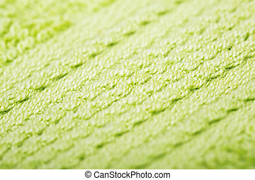 Green cotton fabric texture background. Macro shot.