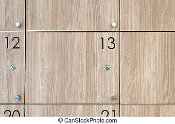 closeup of cabinet number thirteen - wooden locker, closeup...