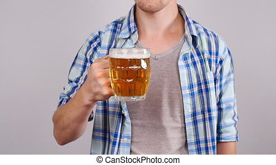 Young Man with a mug of beer on white background