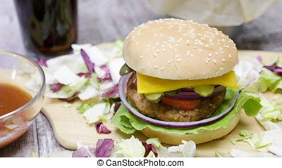 Delicous home made hamburger with fries on wooden table....