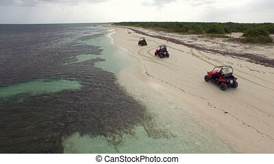 Aerial drone of three jeeps 4x4 racing