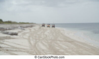 Three jeeps 4x4 driving on the beach