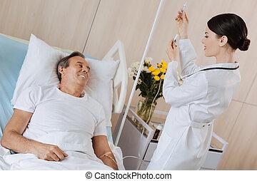 Joyful nice patient smiling
