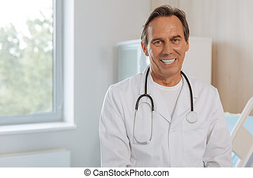 Joyful positive doctor looking at you - Favourite job....