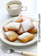homemade new orleans beignet and a cup of coffee - homemade...