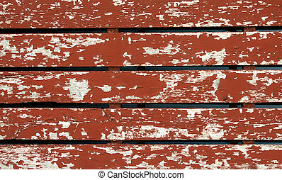 Red board background. - Closeup view of peeling red...