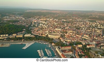 Aerial establishing shot of the ancient city of Pula...