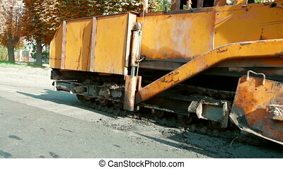 asphalt spreader is used to place the first layer of asphalt...