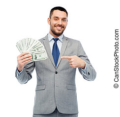 smiling businessman with american dollar money - business,...
