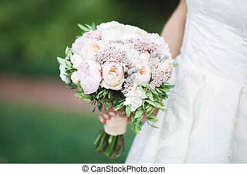 bride holds beautiful wedding bouquet - The bride holds a...