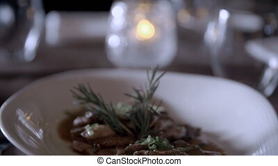 Close up of fine dining meal - A close up tilting down shot...