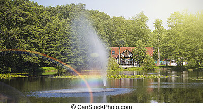 beautiful fountain and rainbow on a lake