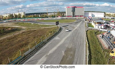 Aerial view of the track with drifting car