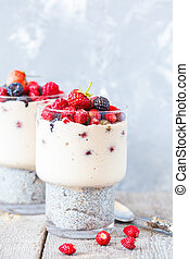 Healthy chia pudding with smoothies and berries in a glass.