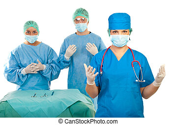 Surgeons team preparing for surgery - Surgeon woman and her...