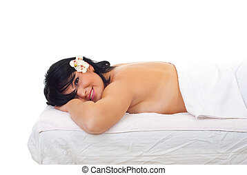 Beauty woman lying on spa massage table and relaxing