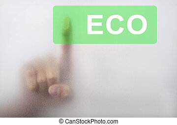 Hand touch the eco button