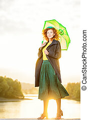 romantic sunset moment - Pretty joyful young woman with...
