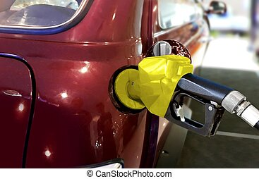 Fueling car with petrol at pump station