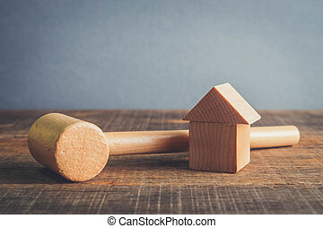Symbol of worldwide real estate crisis. wood hammer and house with filter effect retro vintage style