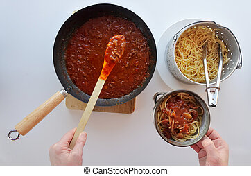 Italian woman cooking homemade Spaghetti Bolognese - POV of...