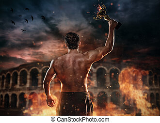 Back view of muscular man holding burning trophy cup,...