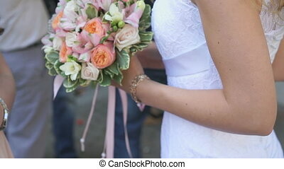 Close-up of bride holding bridal bouquet outdoors - Close-up...