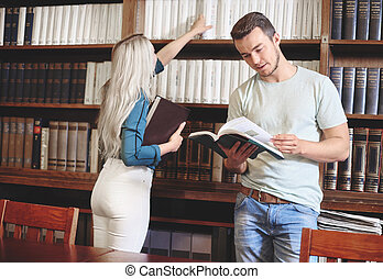 Couple spending spare time in library