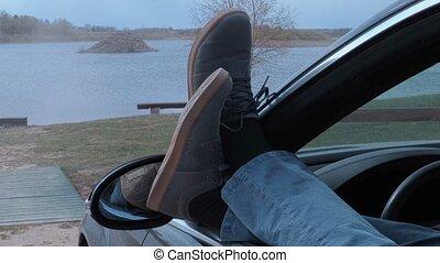 Male's legs in car