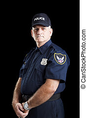 Serious Policeman on Black - Serious portrait of a policeman...