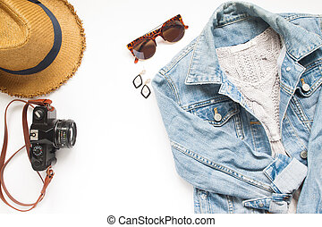 Creative flat lay of Travel items with camera and woman jacket jeans on white background